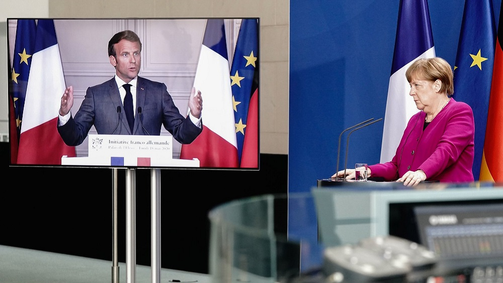 Chancellor Angela Merkel of Germany listens during a joint news conference with President Emmanuel Macron of France, who attended via video link (May 18 Getty)