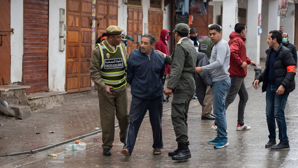 Security forces order to stay home to people after state of emergency declaration as a precaution against coronavirus (COVID-19) in Rabat, Morocco 20 March 2020 (Anadolu Agency)