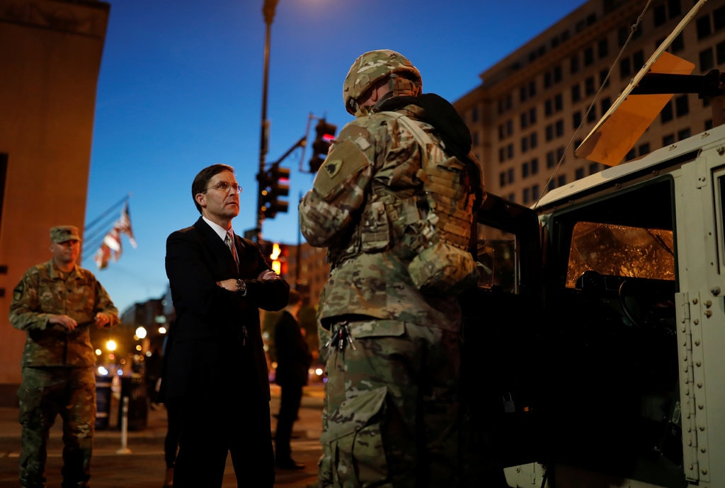 Defense Secretary Mark T. Esper with members of the National Guard near the White House. (Reuters)