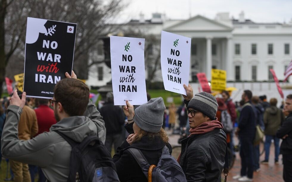 Anti-war activists protest in front of the White House in Washington, DC, on January 4, 2020 (AFP)