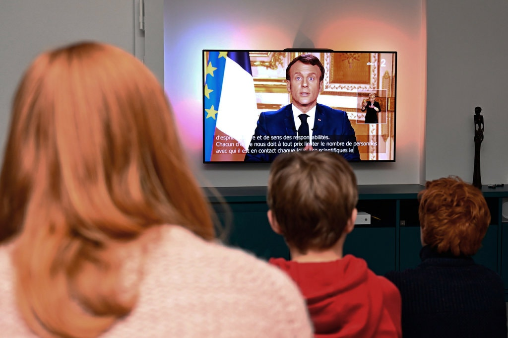 Watching President Emmanuel Macron's address to the nation [Getty]